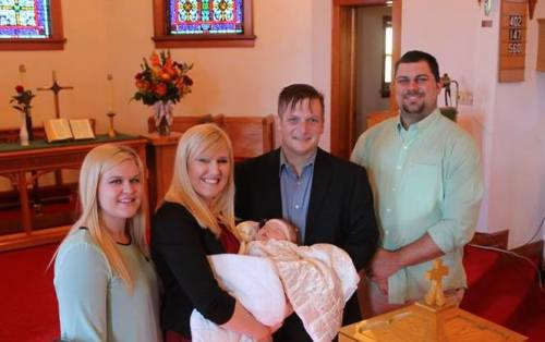 Baby Anna, parents, and sponsors